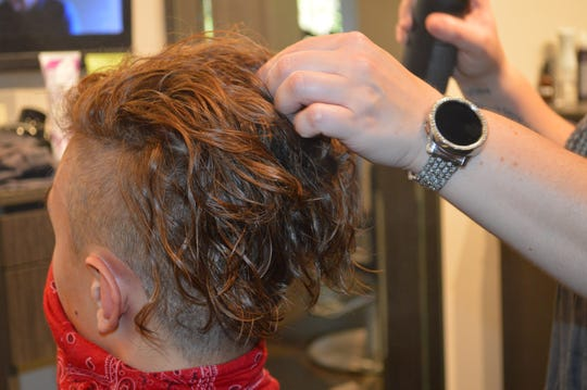 """Spargo Salon & Spa hairstylist Hailey Van Hulst rolled Connor Macleod's hair in all different directions """"to make it look as naturally curly as possible."""""""