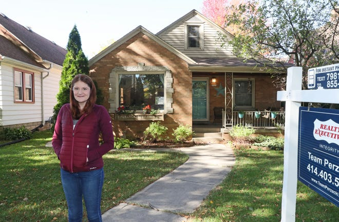 First time homebuyer Elizabeth Duthie in front of the Wauwatosa house she bought and will close on later this month.