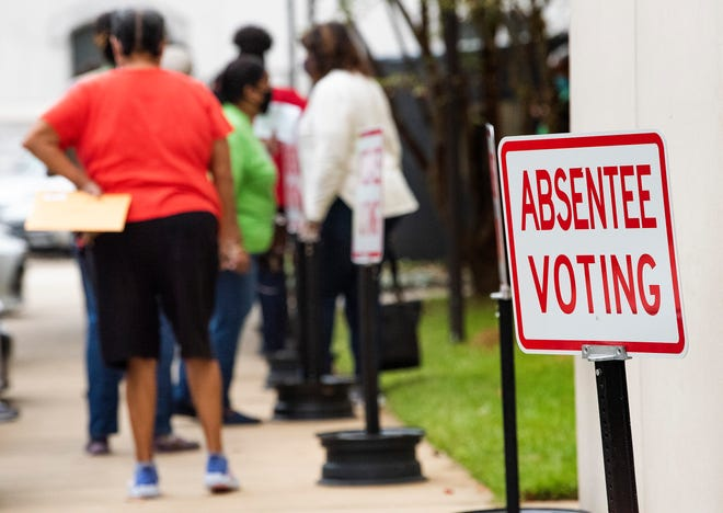 Voters stand in line to vote absentee at the Montgomery County Courthouse in Montgomery, Ala., on Friday October 16, 2020.