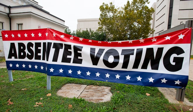 A sign promoting absentee voting at the Montgomery County Courthouse in Montgomery, Ala., on Friday October 16, 2020.