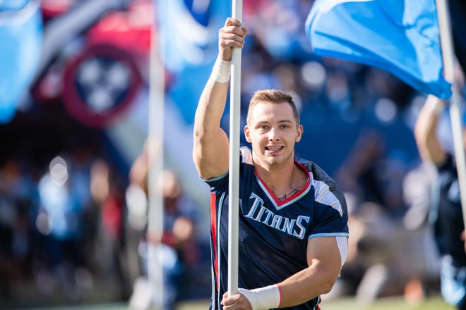 Former Titans cheerleader Patrick Holz died this week of injuries he got in a car wreck earlier this month. In this photo, he led the team onto the field before the game between the Tennessee Titans and the Los Angeles Chargers at Nissan Stadium in Nashville on Oct. 20, 2019.
