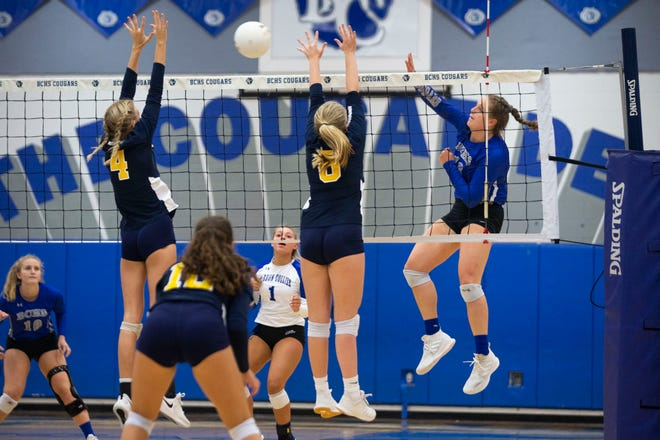 Barron Collier's Skylar English spikes the ball during the Class 5A-District 12 championship volleyball match against Naples held at Barron Collier High School in Naples on Thursday, October 15, 2020.