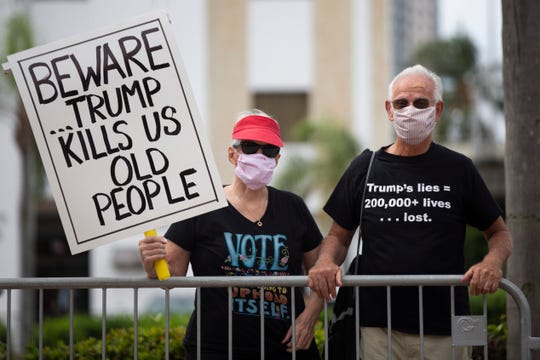 June and Jac Colmer protest before a Trump event at the Caloosa Sound Convention Center and Ampitheater in Fort Myers on Friday, October 16, 2020.