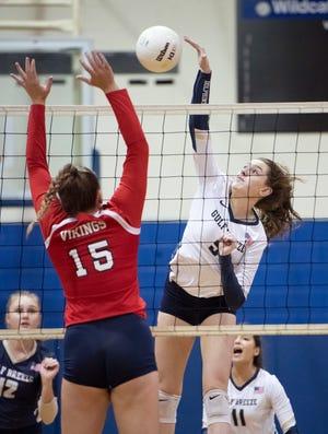 Lauren Kellen (5) plays the ball during the Fort Walton Beach vs. Gulf Breeze district 1-5A volleyball tournament final at Booker T. Washington High School in Pensacola on Thursday, Oct. 15, 2020.
