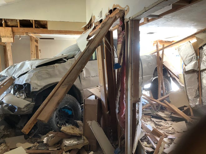 Glendale fire crews worked to free a pickup truck that collided into a house on Friday, Oct. 16, 2020.