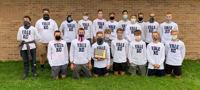 The Yale boys cross country team poses with its Blue Water Area Conference championship trophy on Thursday, Oct. 15, 2020.