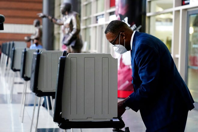 Philadelphia City Council President Darrell L. Clarke fills out his ballot at the opening of a satellite election office at Temple University's Liacouras Center, Tuesday, Sept. 29, 2020, in Philadelphia.  Pennsylvania is one of this year's most hotly contested battleground states and also is facing a flurry of lawsuits, complaints and partisan finger-pointing over its election procedures and systems. (AP Photo/Matt Slocum)
