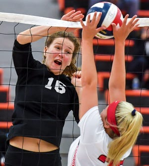 York Suburban's Maddison Perring, left, tries to smash the ball as Alex Somerville of Susquehannock blocks, Thursday, October 15, 2020. John A. Pavoncello photo