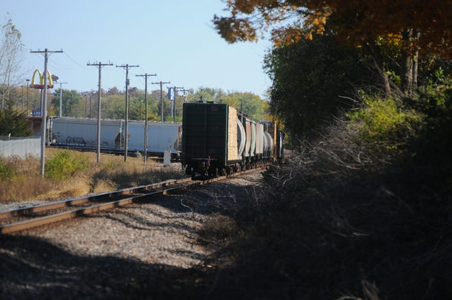 A train that struck a woman stopped west of Gravel Pit Road near railroad cars parked on a spur and a solar park Friday, Oct. 16, 2020.