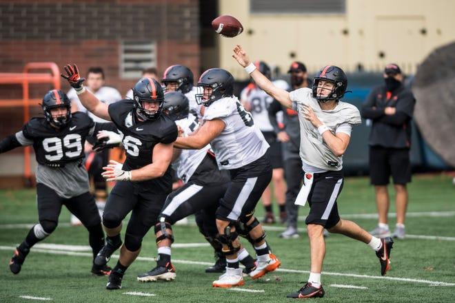 Oregon State quarterback Tristan Gebbia (3) passes during training camp this week in Corvallis.