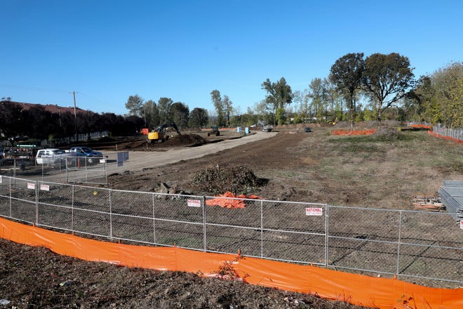 Construction crews work on a site at 865 Hawthorne Ave. SE in Salem, Oregon on Friday, Oct. 16, 2020.