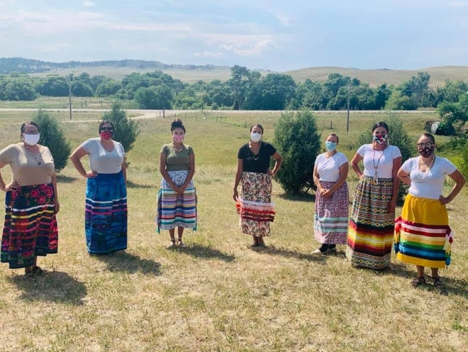 Educators from the Pine Ridge Girls School in Porcupine, South Dakota, gathered for a photo during orientation in August. The school is using distance learning to protect students, teachers and staff from COVID-19 this fall.