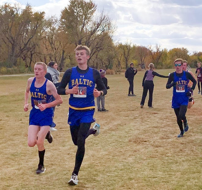 Baltic runners John Gronewold, Bodie Murray and Gavin Holt compete in the Region 2A cross country meet in Sioux Falls on Thursday, Oct. 15.