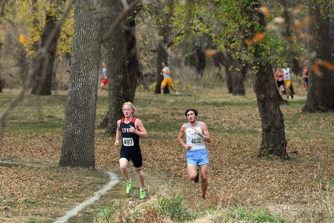 Brandon Valley's Britton Elkin leads Lincoln's Zeb Mendel in the Metro Conference meet in Brandon on Thursday, Oct. 15, 2020.
