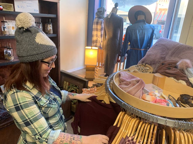 Heather Ness, owner of Tattered Runway in Dell Rapids, looks through items she recently purchased at market in Los Angeles.