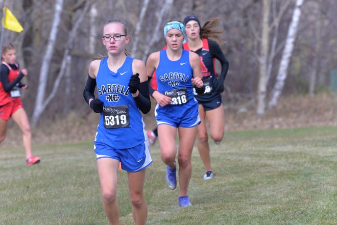 Sartell's Mady Dockendorf (back) and Ashley Nelson (front) run side-by-side in the Section 8AA girls cross country meet. This meet took place at Greenwood Golf Course in Bemidji on Friday, October 16, 2020.