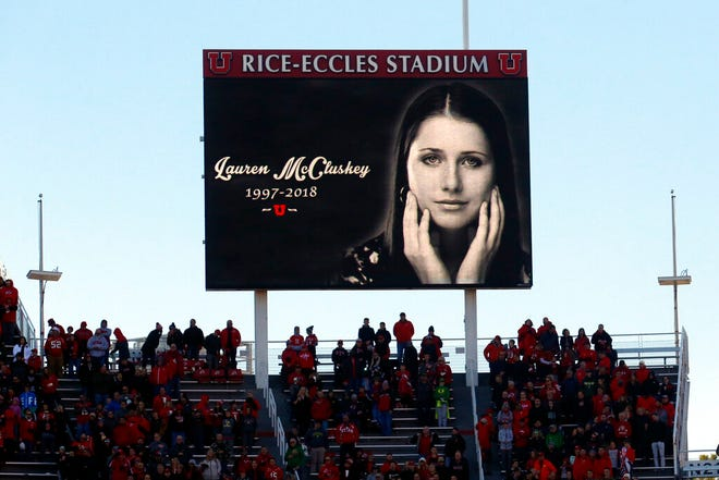 FILE - In this Nov. 10, 2018, file photo, an image of University of Utah student and track athlete Lauren McCluskey, who was fatally shot on campus, is projected on the video board before the start of an NCAA college football game between Oregon and Utah in Salt Lake City. A former University of Utah police officer will not face criminal charges after being accused of sharing explicit photos of a student who was later killed on the campus. prosecutors said Thursday, Oct. 15, 2020. The Salt Lake County District Attorney's Office made the announcement involving Miguel Dera, who was accused of showing co-workers the photos of 21-year-old Lauren McCluskey. (AP Photo/Rick Bowmer, File)