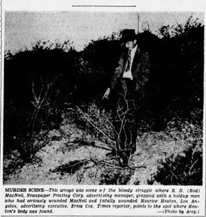 Feb. 10, 1948: This arroyo was scene of the bloody struggle where R.D. (Rod) MacNeil, Newspaper Printing Corp. advertising manager, grappled with a holdup man who had seriously wounded MacNeil and fatally wounded Maurice Heaton, Los Angeles, advertising executive. Ernie Cox, Time reporter, points to the spot where Heaton's body was found.