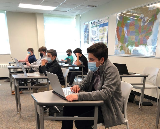 Students attend classes with new safety precautions in place at Fordham Preparatory School.