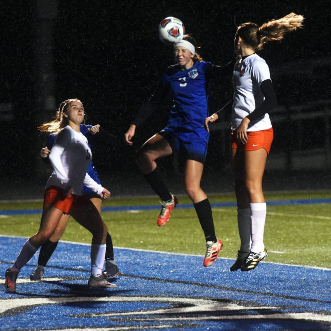Zanesville's Jillian Wiersma heads the ball off a corner kick during the second half of a 2-1 loss to visiting Heath in a Licking County League match on Thursday at John D. Sulsberger Memorial Stadium.
