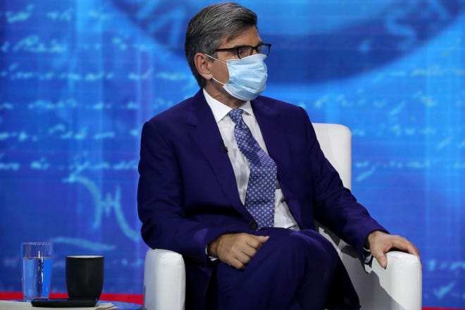ABC News Chief Anchor George Stephanopoulos prepares for a town hall format meeting with Democratic presidential nominee Joe Biden at the National Constitution Center Oct. 15, 2020 in Philadelphia.