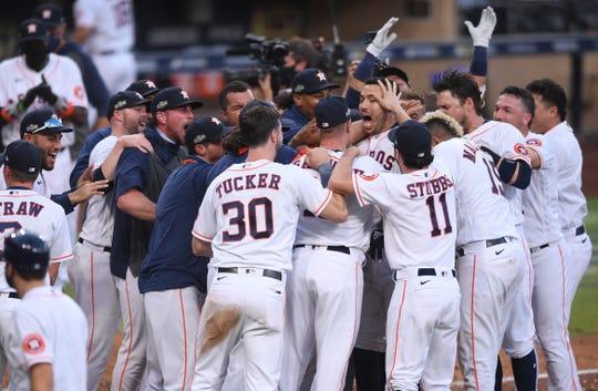 Game ALCS 5: Astros players celebrate Carlos Korea's homer.