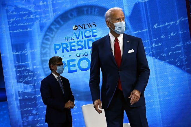 Democratic Presidential candidate and former US Vice President Joe Biden, right, and moderator George Stephanopoulos arrive for an ABC News town hall event at the National Constitution Center in Philadelphia on October 15, 2020.