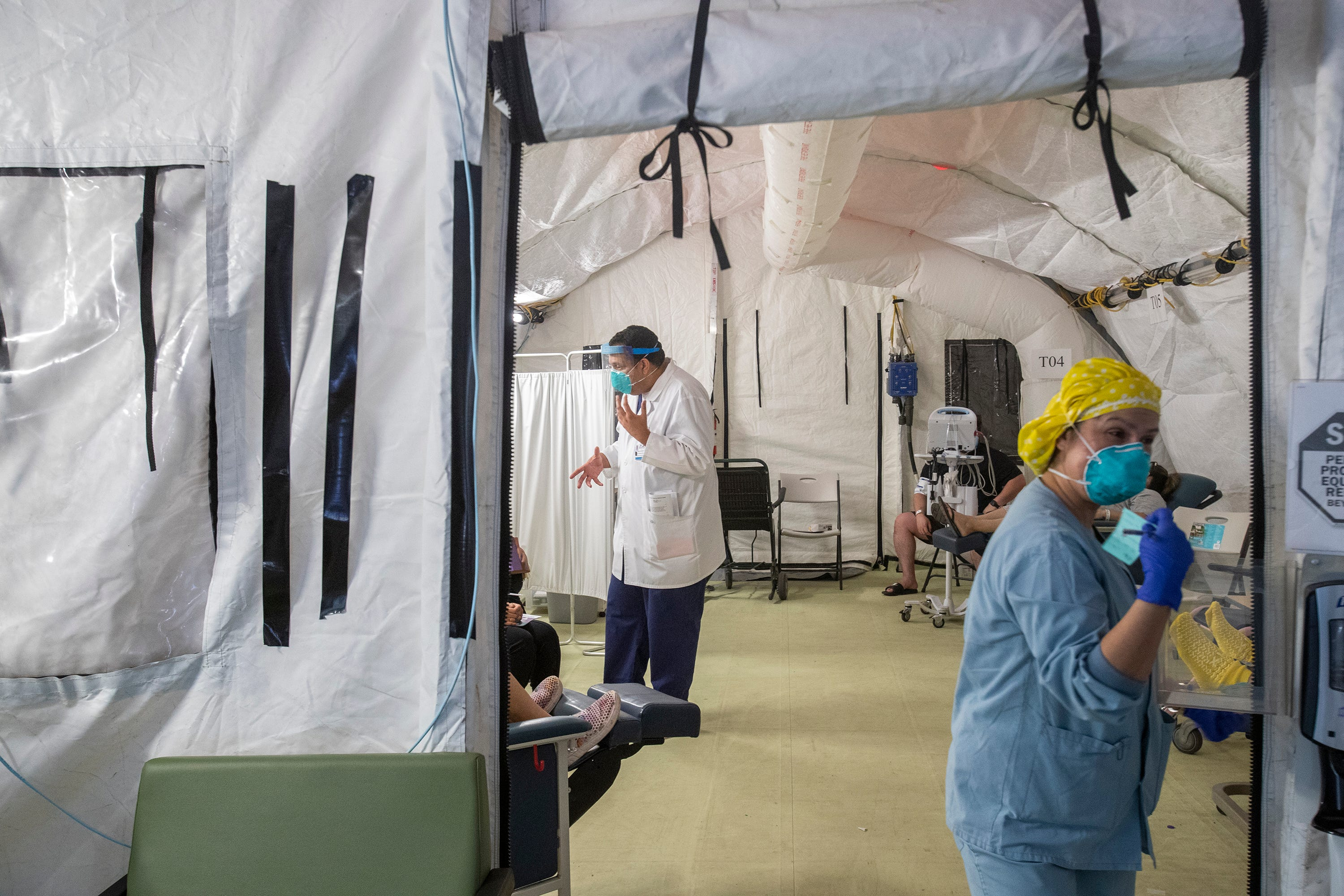 El Centro Regional Medical Center staff attend to suspected COVID-19 patients on May 30, 2020.