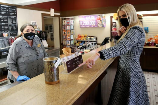 Ivanka Trump, an advisor to President Donald Trump and his daughter, places an order at Graeter's ice cream shop in Mariemont, Ohio, after speaking at a campaign rally, Friday, Oct. 16, 2020, in Cincinnati.