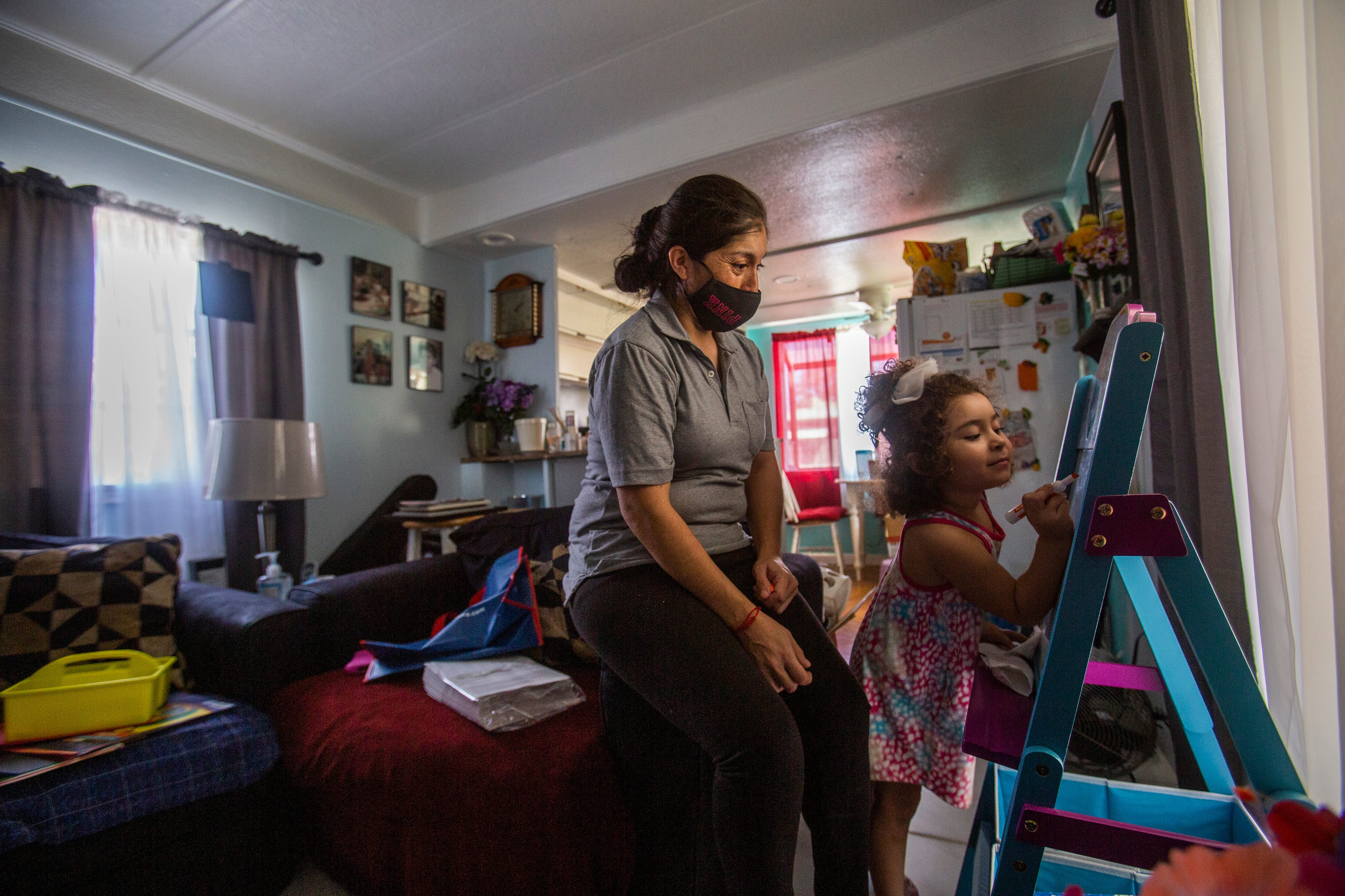 Guadalupe Serreno and her daughter, Luna, live in a one-bedroom mobile home with Guadalupe's elderly father. Serreno is unable to provide for her family without the help of her father's Social Security payment because her wages as a farm worker do not cover all of their expenses. She has been working in the fields of Imperial Valley for 20 years.