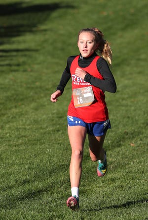 Ellie Meech of Revere races to a first-place finish in the Suburban League American Conference race at Silver Creek Metro Park on Saturday.