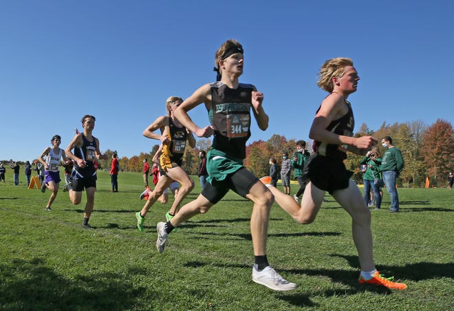 Runners  head to the one mile mark during the Suburban League National Conference race at Silver Creek Metro Park Cross Country Course on Saturday, Oct. 17, 2020 in Norton. [Mike Cardew/Beacon Journal]