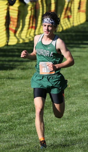 Matthew Singleton of Aurora races to a first-place finish in the Suburban League American Conference race Saturday.