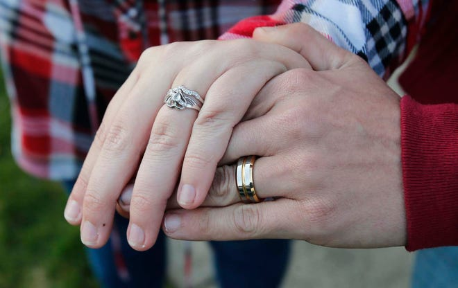 Newlyweds Kennedy and Jefrey Hambel show off their wedding rings on Friday.