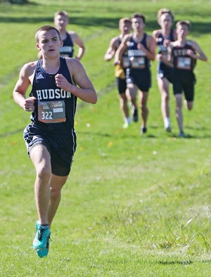 Elliot Durkee of Hudson leads the race as he heads to a first-place finish during the Suburban League National Conference race on Saturday.