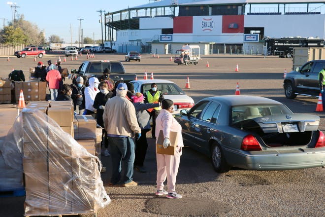 More than 11,000 boxes of food were expected to be distributed at Saturday morning's Farmers to Families food box distribution in the parking lot of Dick Bivins Stadium.  [Neil Starkey / For the Amarillo Globe-News]