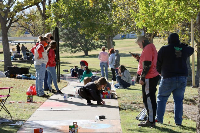 Approximately sixty teams from area middle and high schools compete in the Art in the Park Chalk competition hosted by the Texas Panhandle Art Education Association Saturday at Medi Park. [Neil Starkey / For the Amarillo Globe-News]