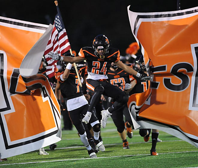 Marlington's Nolan Hooker leads the Duke's on to the field against Coventry Friday, October 16, 2020.