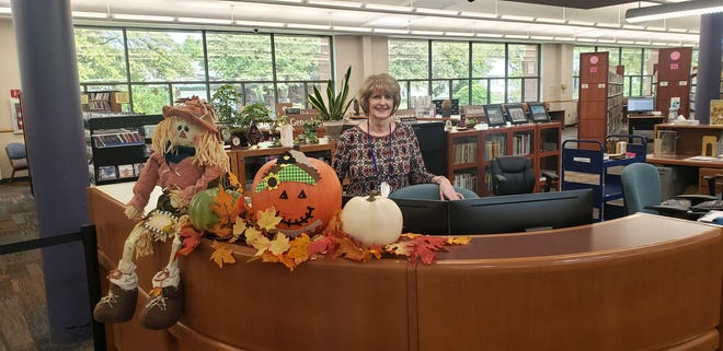 Public Services Librarian Lorena Smith stands by her desk at the Ardmore Public Library. She will be retiring this Friday after 40 years of service.