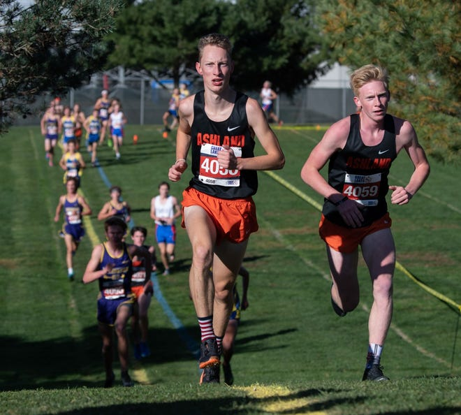 Ashland's Josh Hawley (left) and Dylan Hickey run side by side during the Ohio Cardinal Conference Championships Saturday morning at Wooster High School. The duo helped the Arrows win their third consecutive OCC team title.