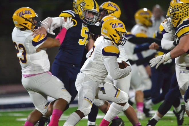 OLSH quarterback Jay Pearson runs up the field during Friday night's game against Shenango.