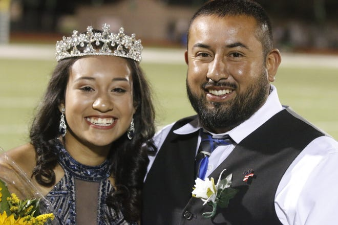 Bangs High School  senior Kimberly Diaz is pictured with her father, Christopher Diaz, after being crowned homecoming queen Friday night at Dragon Memorial Stadium. The Dragons defeated Ingram Moore 47-15  to remain undefeated.