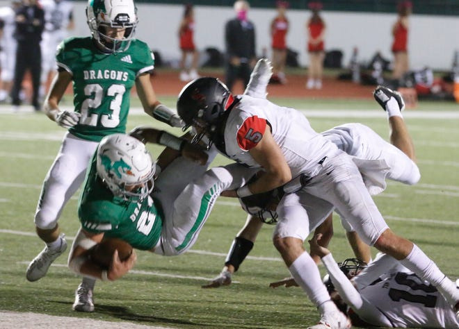 Dragons running back Ethan Sanchez crashes into the end zone after an 11-yeard scoring run in second quarter action  Friday night.