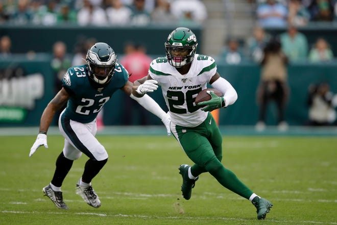 New York Jets' Le'Veon Bell, right, rushes past Philadelphia Eagles' Rodney McLeod during a game Oct. 6, 2019, in Philadelphia.