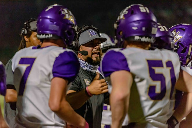 Hallsville head football coach Justin Conyers talks with his team during its game last week.