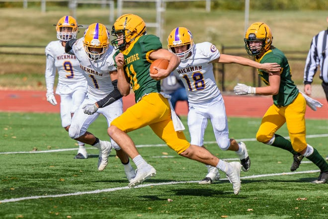 Rock Bridge quarterback Nathan Dent (11) runs past Hickman's Jaiden Tandy (1) and Tyler Horn (18) en route to scoring a touchdown during the annual Providence Bowl game Saturday afternoon at Rock Bridge High School.