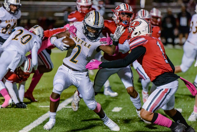 Battle's Gerry Marteen Jr. (2) tries to break through against Jefferson City during a game Oct. 16 at Jefferson City High School.