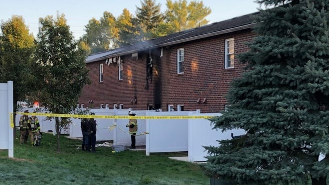Firefighters investigate the scene of a Westerville fire in which one person died.