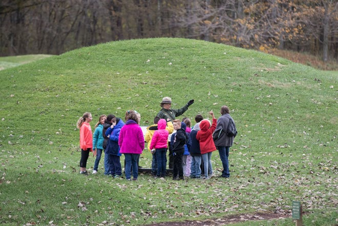 A group of children visit the Hopewell Culture National Historical Park on Friday, November 2, 2018, while U.S. Sen Rob Portman and other dignitaries tour the park.