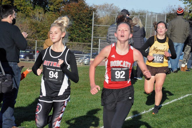 Rittman's Pyper Gibson battles Norwayne's Annabel Stanley for the lead in Saturday's WCAL Championship race, followed closely by Waynedale's Kylee Gray. Gibson ended up finishing first for the individual title.
